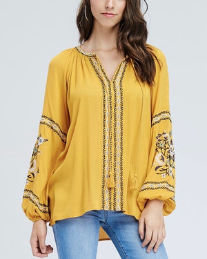 peasant blouse with embroidered detailing in mustard