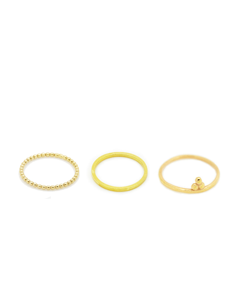 Golden little finger stack by may hofman jewellery