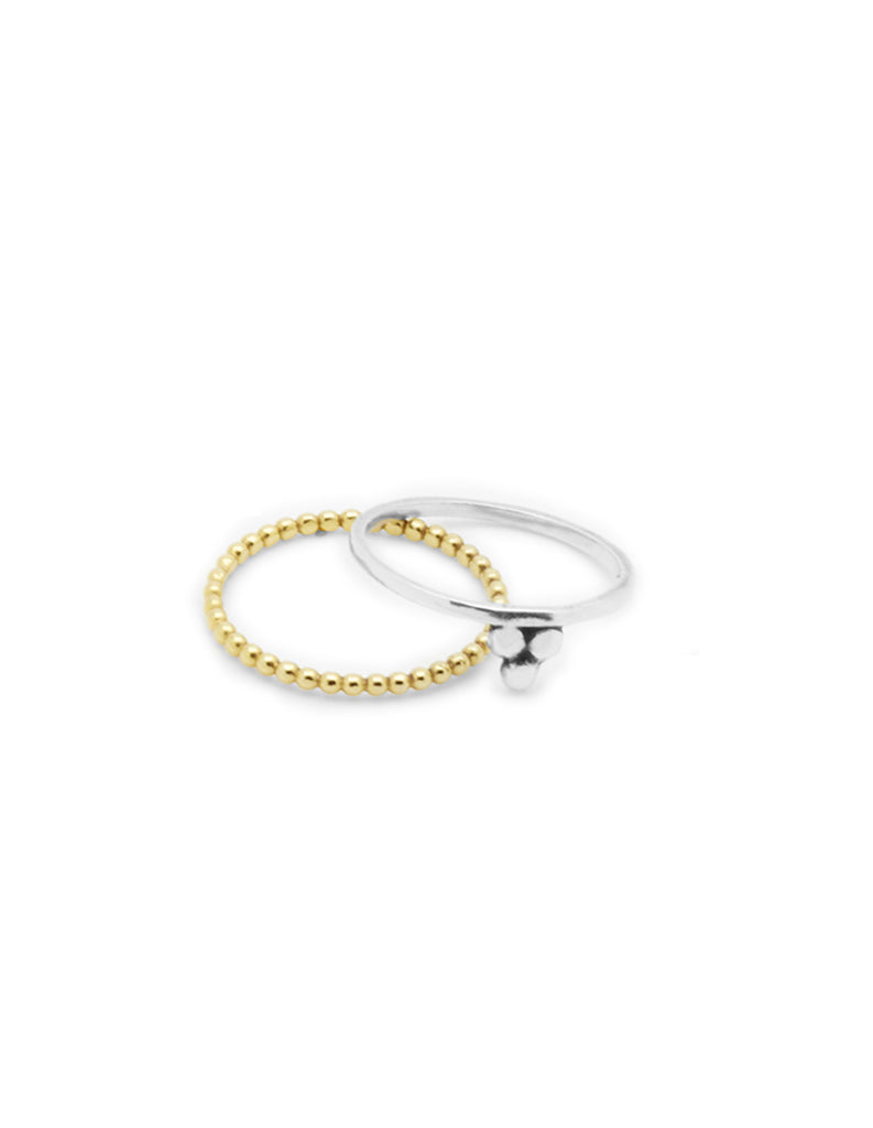 silver om and gold halo stacking rings may hofman jewellery