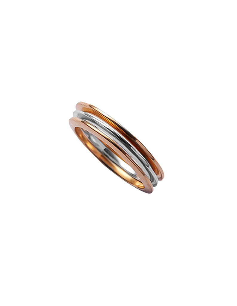 Stack of X rings in silver and gold by May Hofman Jewellery