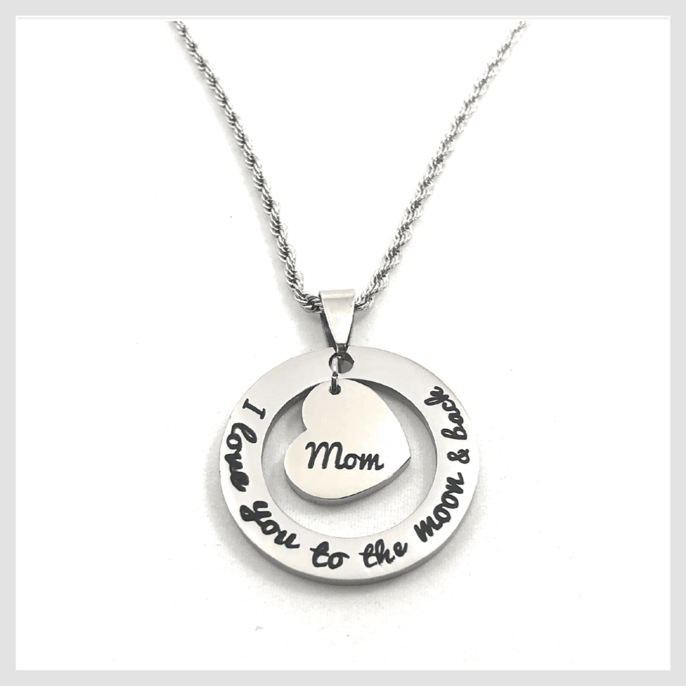 "Pendant necklace circle cutout with the message  I Love You To the Moon and Back inscribed around the circle. Mom heart in the center. Comes with 18"" stainless steel rope chain."