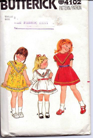 Butterick 4102 Girls Top Stitched Party School Dress Pull Over Short Sleeves Vintage 1980's Sewing Pattern - VintageStitching - Vintage Sewing Patterns