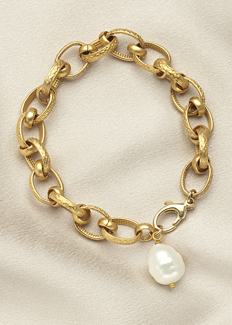 Heavy gold plate chain with white shell pearl drop