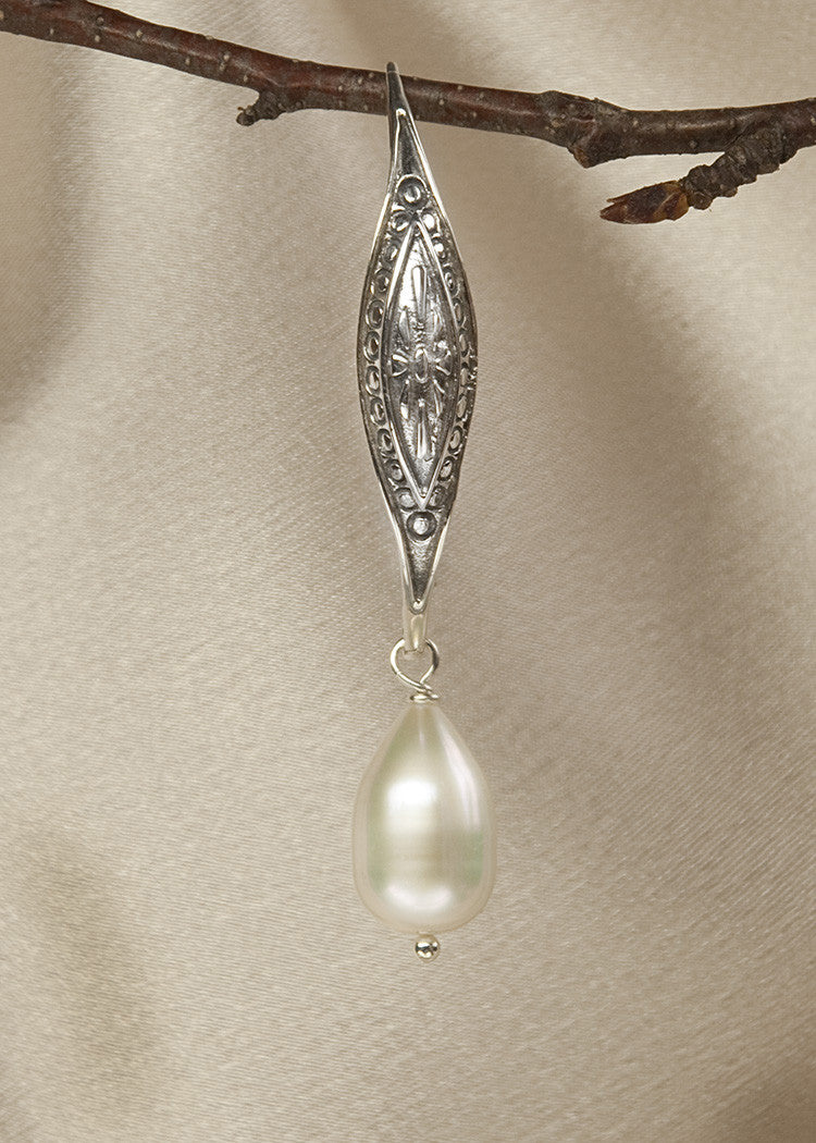 Intricately carved, large sterling ear wire, with pearl drop
