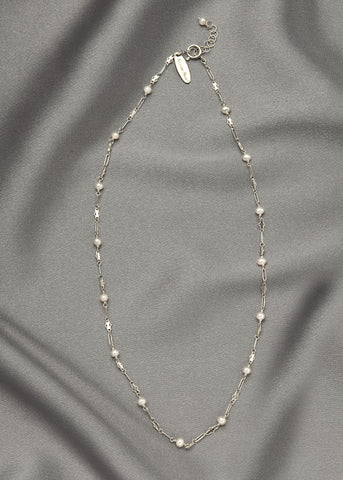 Tiny white seed pearls joined with a unique sterling silver chain