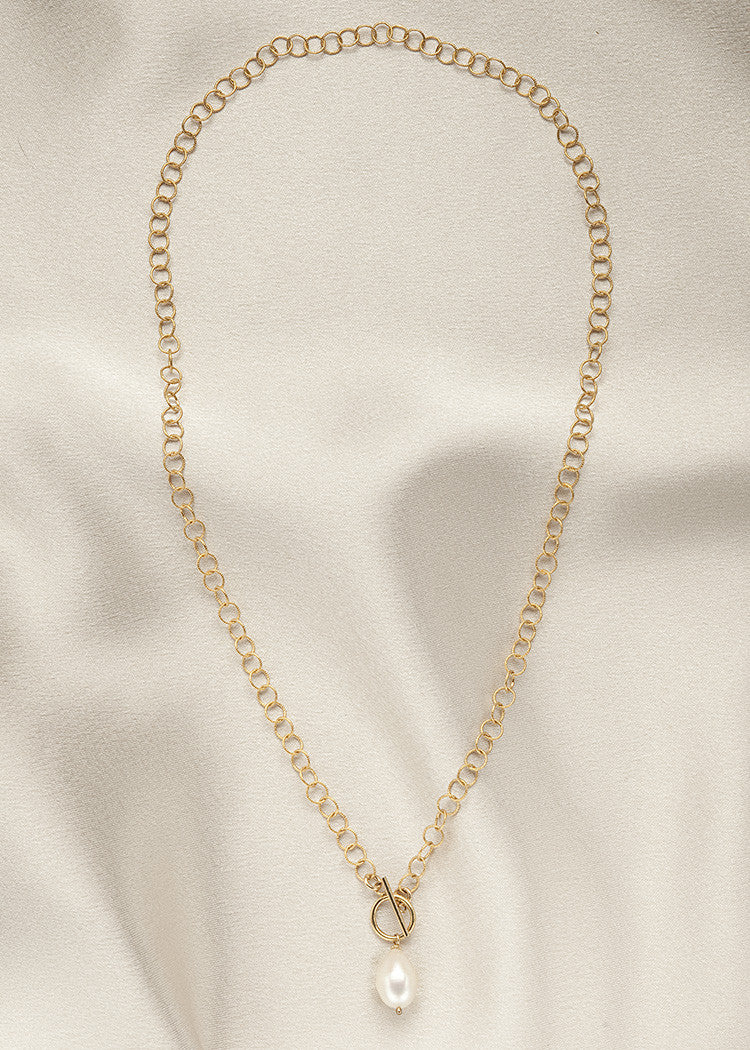 Small round, lightweight 14k gold fill chain, with a front closing toggle clasp, and a small pearl drop