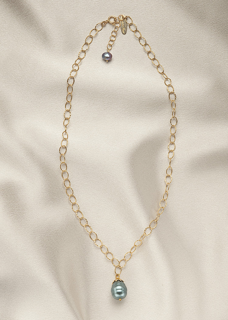Unique 14k gold fill chain with a teal colored, baroque, 14mm shell pearl, and a vermeil cap