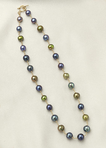 Iridescent shades of blue and green pearls connected with 14k gold fill wire wrap