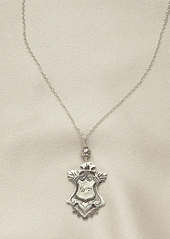 "All sterling silver, antique medal from England, with the initials ""WF"""