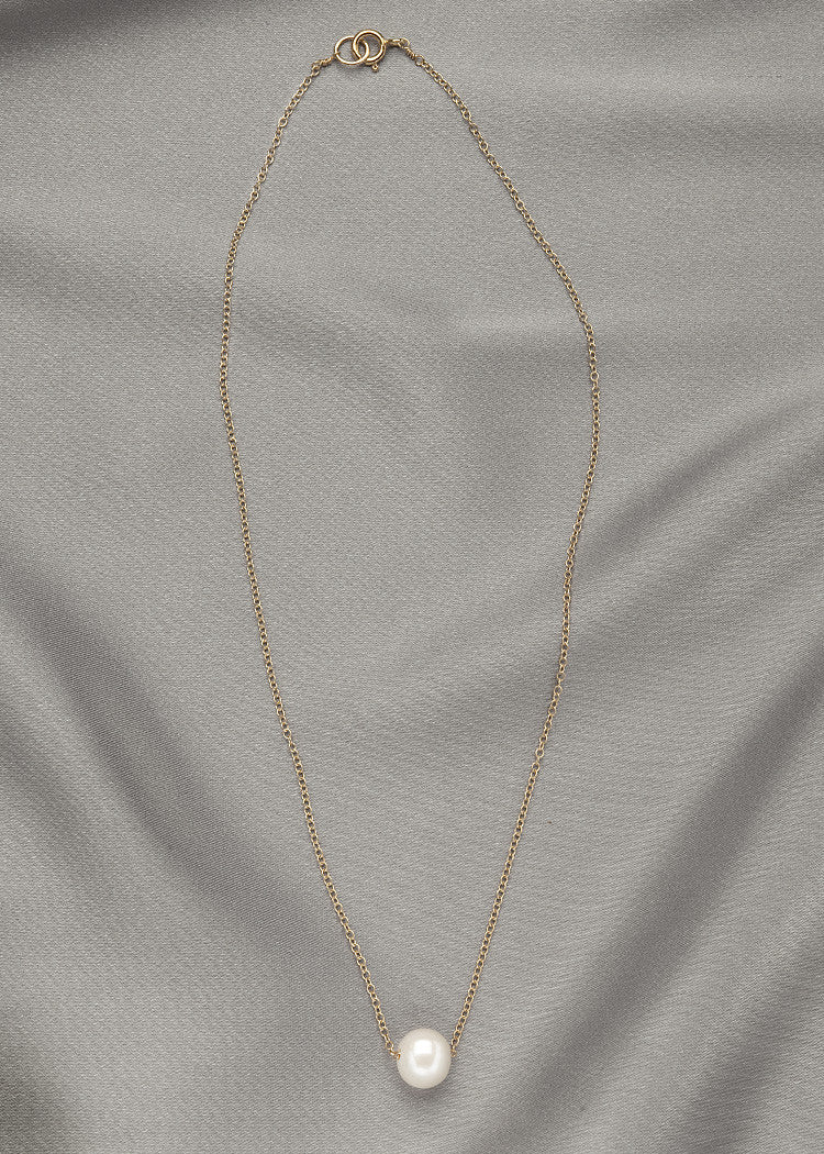 Single white pearl, floating on a 14k gold fill chain