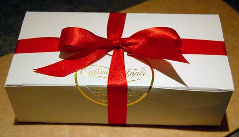 red ribbon gift wrapping box of fudge
