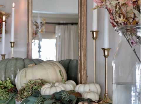 fall-themed mantle with white pumpkins