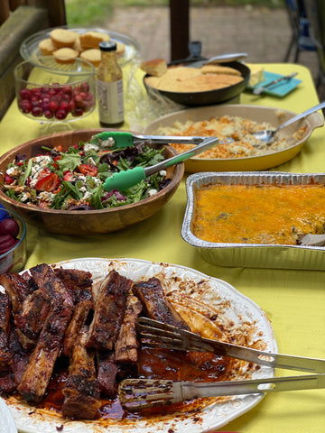 bbq spread, with ribs, salad and corn cake