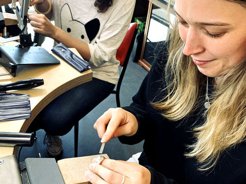 Student filing her sterling silver ring | Silver Ring Making Workshop | Pod Jewellery