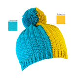 A half and half crochet bobble hat, split vertically in Turquoise and Buttercup Yellow by VelvetVolcano