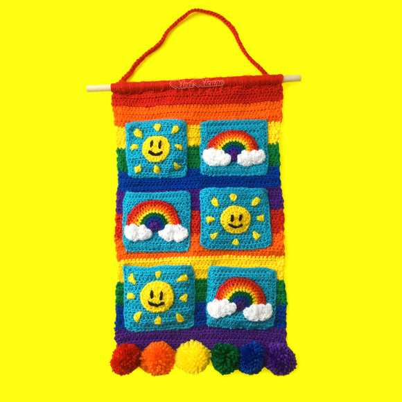 Sunshine & Rainbows Hanging Organiser - Colourful Rainbow Striped Crochet Wall Art with Sun and Rainbow Cloud Pockets and Pom Pom Trim by VelvetVolcano