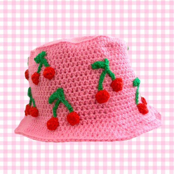 Womens Bubblegum Pink Crochet Bucket Hat with Cherry Applique Repeating Pattern by VelvetVolcano