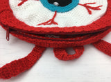 Zip opening, hanging hook and straps detail on Crochet Eyeball Backpack by VelvetVolcano