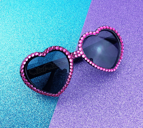 VelvetVolcano Barbie Pink & Black Sparkly Heart Sunglasses on Turquoise and Purple Glitter Background