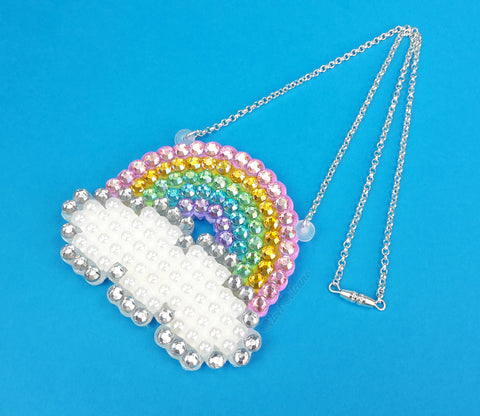 Sparkly Pastel Rainbow Cloud Necklace - Rhinestone Encrusted Necklace with a Pastel Rainbow over a White Pearl and Silver Crystal Cloud on a silver plated chain by VelvetVolcano