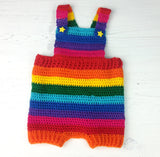 Brightly Coloured Rainbow Striped Crochet Baby Dungarees with Yellow Star Button Fastenings made from Acrylic Yarn in Red, Orange, Yellow, Green, Turquoise, Royal Blue, Purple and Pink.