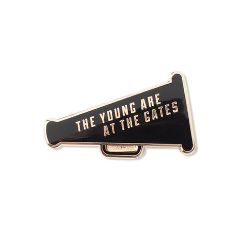 The Young Are At The Gates Enamel Pin in Black and Gold Megaphone Design