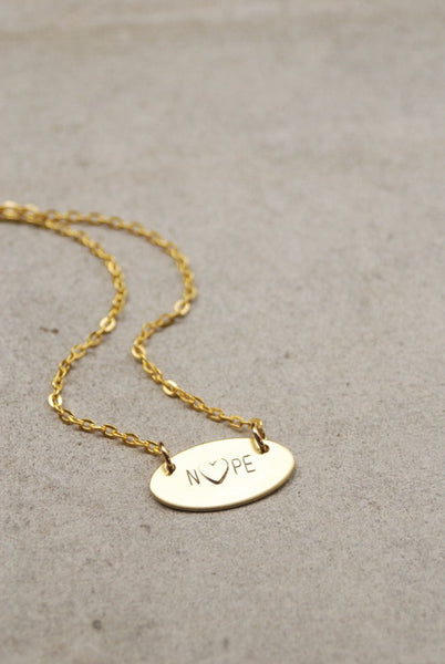 The Betty Collection: Nope Heart Necklace in Brass