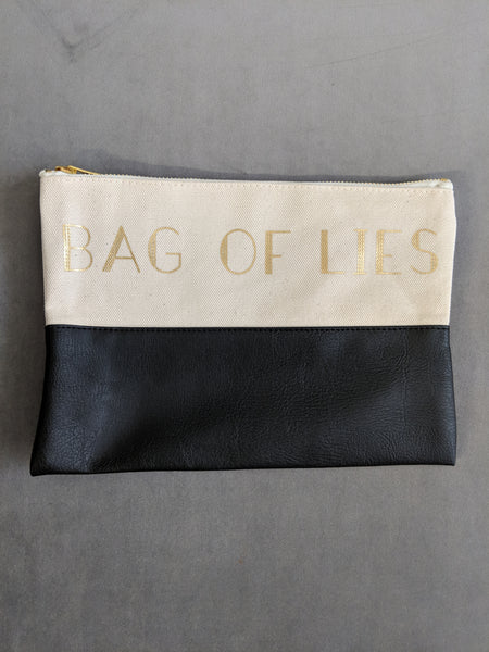 Bag Of Lies Black Colorblock Funny Makeup Bag in Canvas Faux Leather