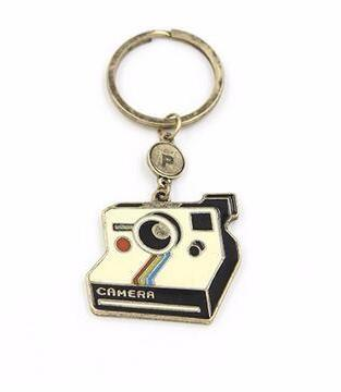 Polaroid Camera Graphic Keychain in Black and Gold