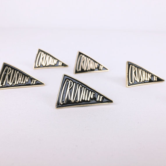 Crushin' It Enamel Lapel Pin in Black and Gold