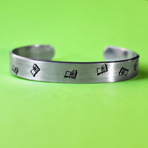 Books Aflutter Hand Stamped Unisex Cuff Bracelet in Silver