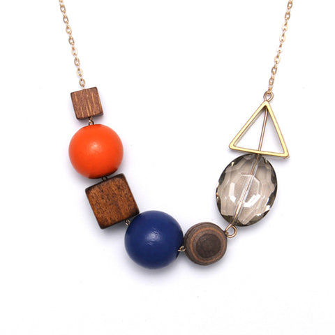 Delicate Asymmetrical Statement Necklace in Wooden Blocks and Baubles