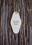 Stay Gold Motherfucker Hotel/Motel Style Keychain in White and Gold