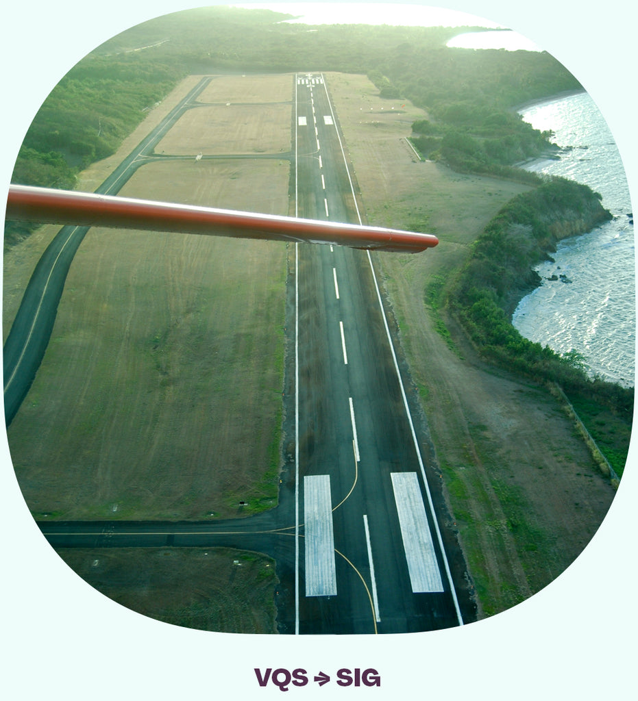 Looking back at a runway from a plane