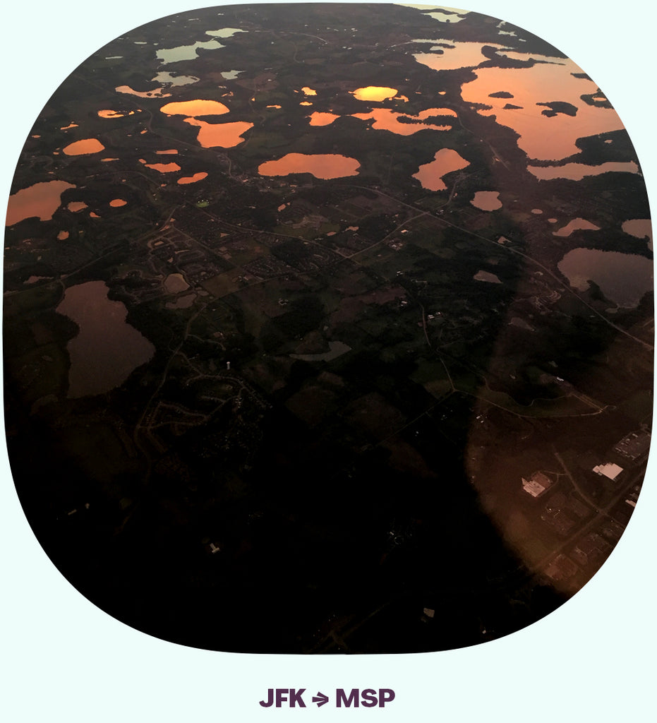 Many lakes, seen from above, with the reflection of a sunset