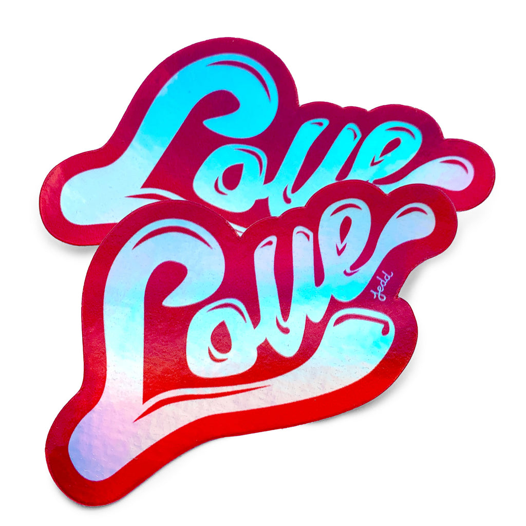 Two holographic stickers with a design that say Love