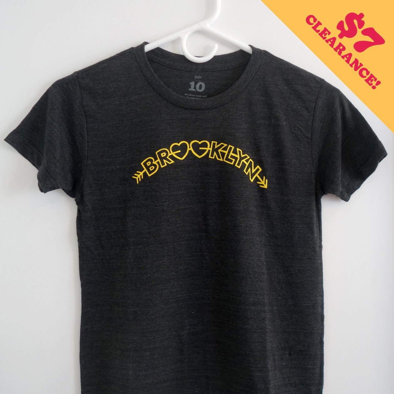 "A youth t-shirt with a design reading ""Brooklyn"" with the o's shaped like hearts"