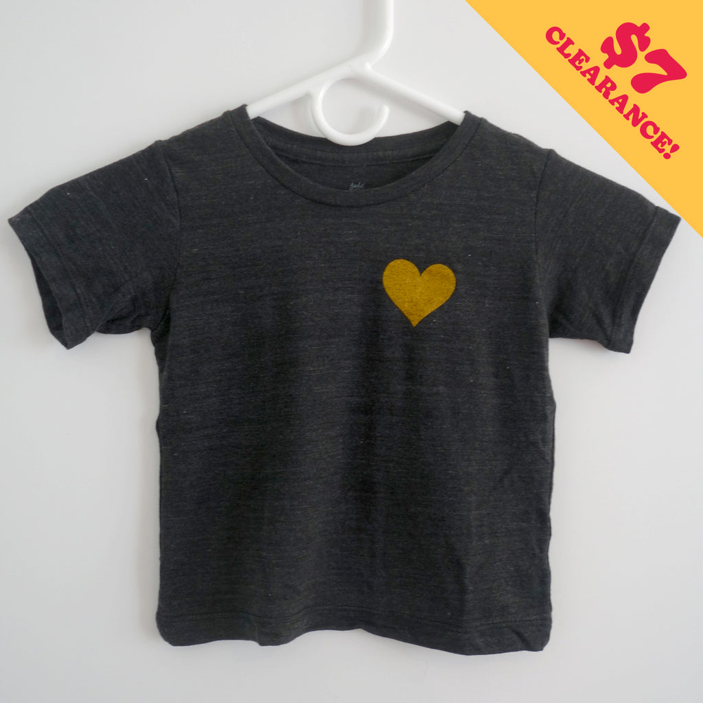 A t-shirt with a heart of gold print.