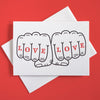 "Greeting card with playful illustration of two fists that says ""Love Love"""