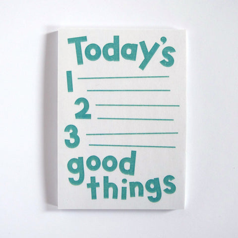 "Notepad with hand drawn type reading ""Today's 1, 2, 3 Good Things"""