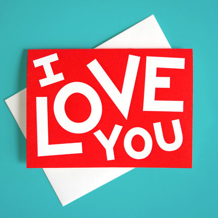 "A bright red greeting card that reads ""I Love You"""