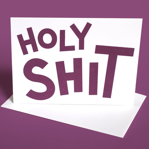 "Greeting card with playful typography that says ""Holy Shit"""