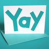 "Greeting card with playful typography that says ""Yay"""