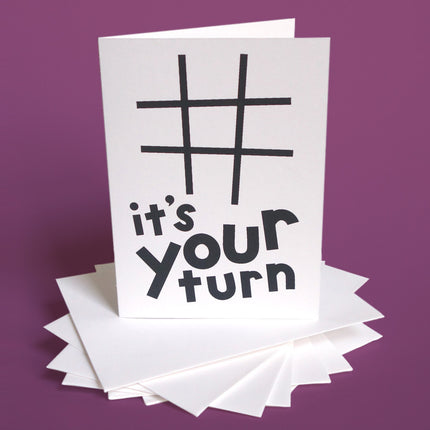 "Greeting card with playful typography that says ""It's Your Turn"""