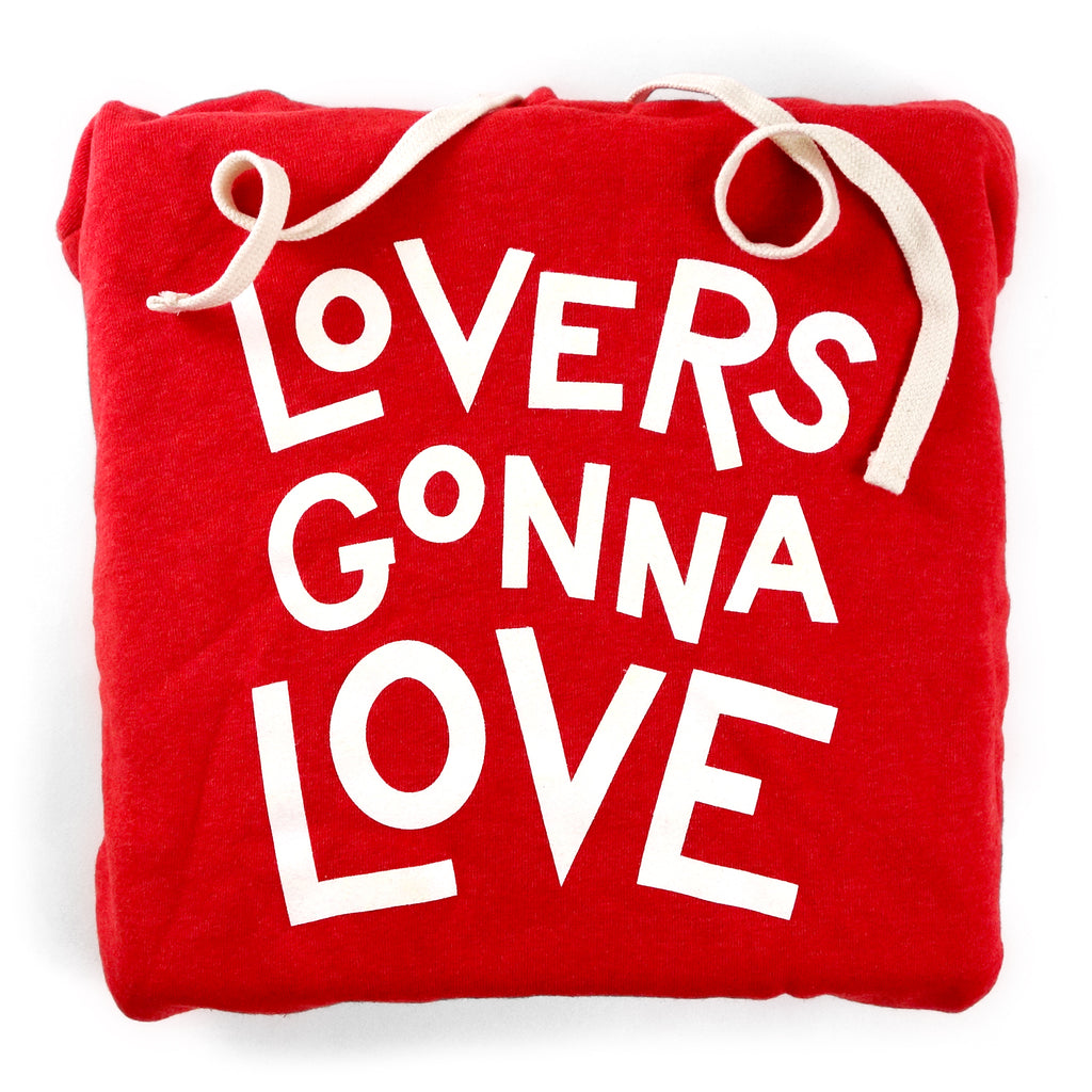 "A photo of a red hoodie that says ""Lovers Gonna Love"""
