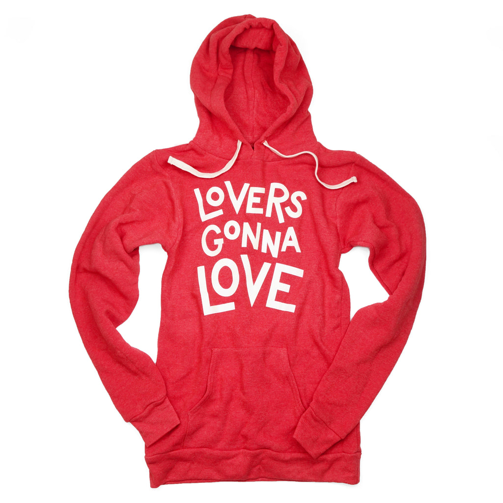 "A red hooded sweatshirt with white letters reading ""Lovers Gonna Love"""