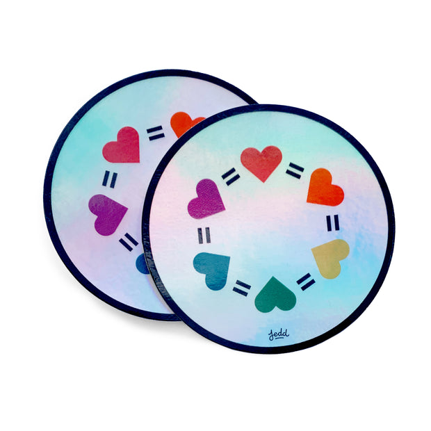Two holographic stickers with a design that has hearts and equal signs
