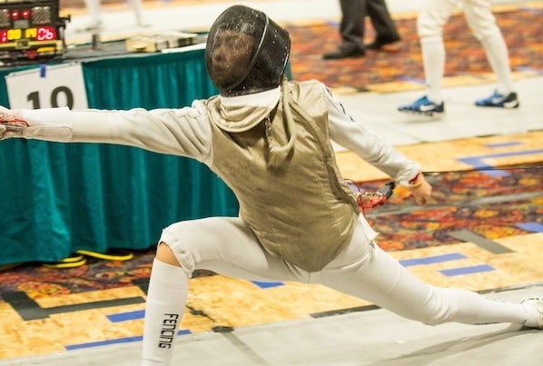 Julia: lunge in fencing tournament