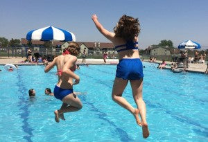 Dragonwing teen ambassador Madi and sister jumping into pool
