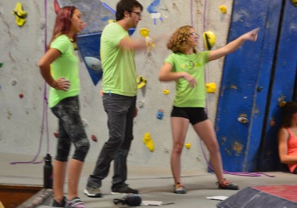Dragonwing Ambassador Madi with rock climbing coaches at competition